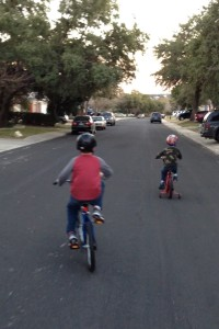 Boys riding their bikes down hill